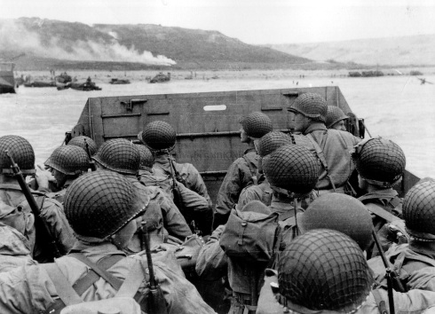 American troops watch activity ashore on Omaha Beach as their LCVP landing craft approaches the shore in this June 6, 1944 handout photo